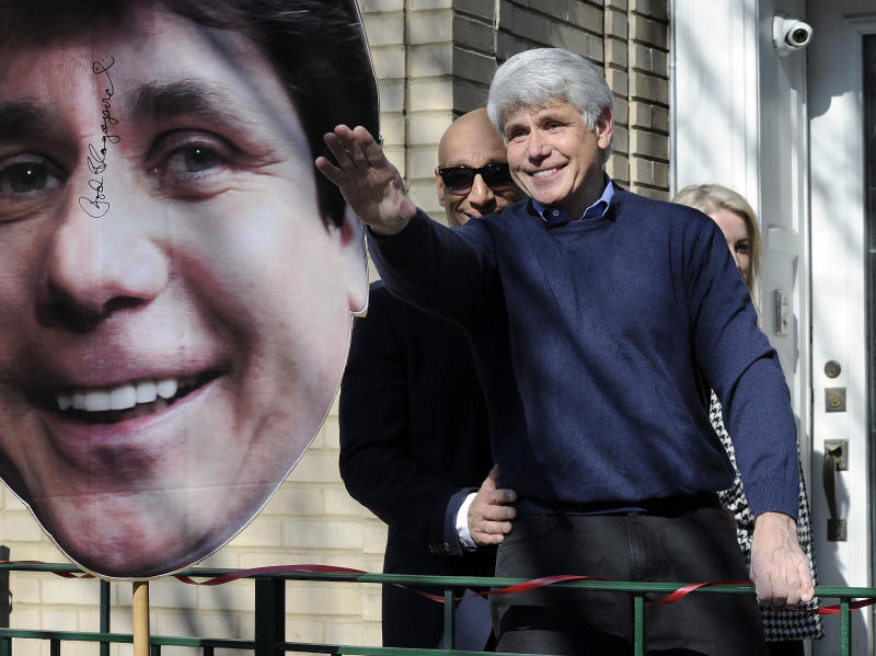 Former Illinois Gov. Rod Blagojevich waves to his friends after giving a press conference at his Chicago home on Wednesday, Feb. 19, 2020, one day after having his prison sentence commuted by President Donald Trump. (Mark Welsh/Daily Herald via AP)/Daily Herald via AP)