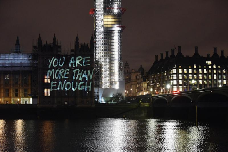Messages are projected onto the Houses of Parliament to mark the start of International Women's Day on March 7, 2018: Getty Images for GladLife Ltd