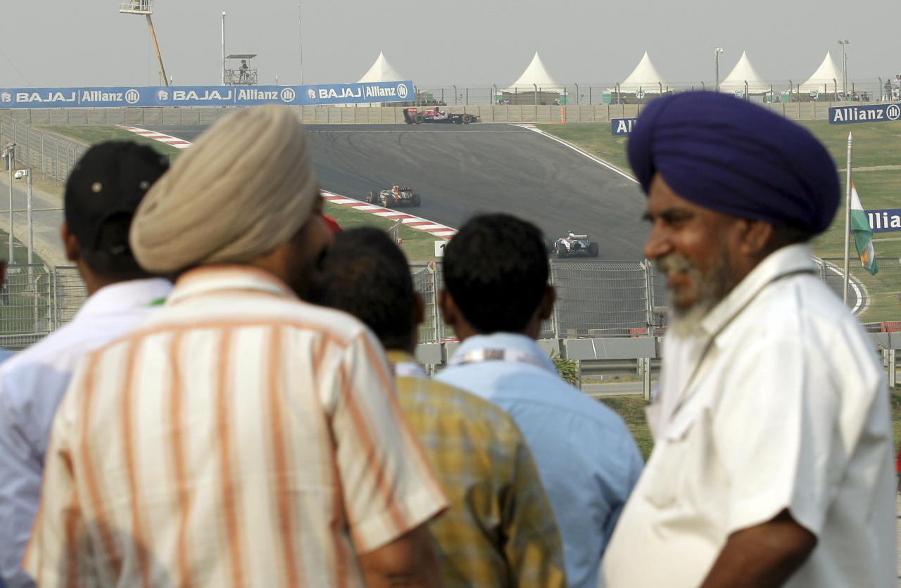 Indian spectators look on during the Indian Formula One Grand Prix at the Buddh International Circuit in Noida, 38 kilometers (24 miles) from New Delhi, India, Sunday, Oct. 30, 2011. (AP Photo/Luca Bruno)