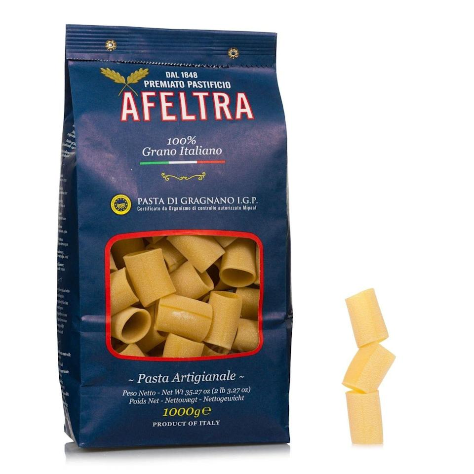 """<p>eataly.com</p><p><strong>$10.90</strong></p><p><a href=""""https://www.eataly.com/us_en/pasta-pantry/pasta/afeltra-100-italian-grain-paccheri-35-3-oz"""" rel=""""nofollow noopener"""" target=""""_blank"""" data-ylk=""""slk:Shop Now"""" class=""""link rapid-noclick-resp"""">Shop Now</a></p><p>We all know and love a carb loader, so why not gift them a splendid Italian made pasta. Think of this fun shaped pasta, called Paccheri, like oversized rigatoni. It's perfect for catching loads of delicious sauce.</p>"""