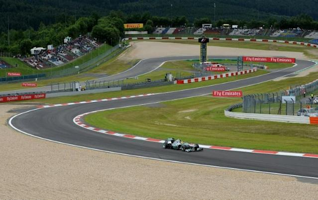 Nico Rosberg's Mercedes navigates a bend at the Nurburgring in 2013, the last time a Grand Prix was held there but the historic German circuit will be pressed into action this season (AFP Photo/Tom GANDOLFINI)