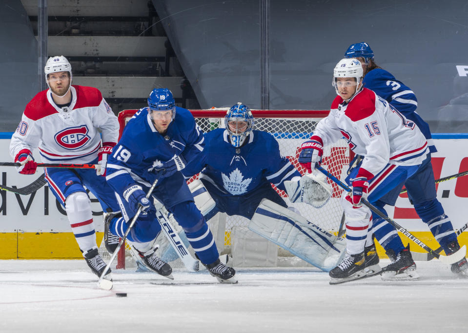 TORONTO, ON - JANUARY 13: Frederik Andersen #31 of the Toronto Maple Leafs guards the net with teammate Jason Spezza #19 against Jesperi Kotkaniemi #15 and Joel Armia #40 of the Montreal Canadiens during the third period at the Scotiabank Arena on January 13, 2021 in Toronto, Ontario, Canada. (Photo by Mark Blinch/NHLI via Getty Images)