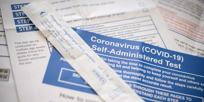 The packaging from a disposable oropharygeal swab sampler and the instructions from a COVID-19 self-administered test kit provided by the Department of Health and Social Care are seen on May 08, 2020 in London, England.