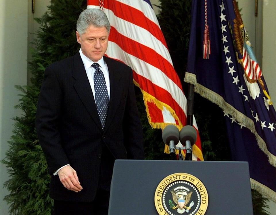 Bill Clinton walks to the podium moments before reading a statement in the Rose Garden of the White House after the Senate voted not to impeach him on 12 February 1999. Clinton apologised for the actions that led to his impeachment and subsequent acquittal by the Senate, saying he was 'profoundly sorry' (STEPHEN JAFFE/AFP via Getty Images)