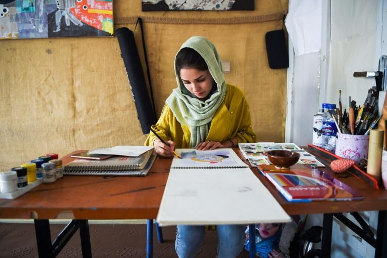 24-year-old artist and designer Zahra in Kabul is one of many Afghan women who fear what a deal between the US and the Taliban will bring