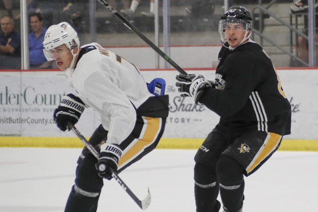 FILE - In this Sept. 13, 2019, file photo, Pittsburgh Penguins' star players Sidney Crosby, right, and Evgeni Mallkin take part in an NHL hockey practice, in Cranberry Township, Pa. The Penguins head into the season looking to prove their early playoff exit last spring was not the beginning of the end of their long run of success. They traded away forward Phil Kessel to Arizona but kept the rest of its core intact as it eyes a 14th straight playoff berth. (AP Photo/Keith Srakocic, File)