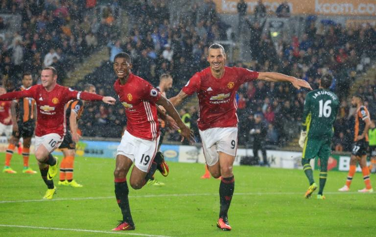 Manchester United's striker Marcus Rashford (2nd L) celebrates with Zlatan Ibrahimovic after scoring on August 27, 2016