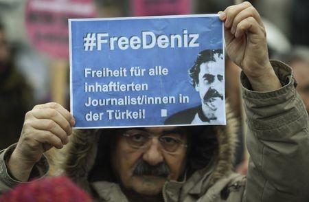 A protester demands the release of jailed Turkish-German journalist Deniz Yucel in Hamburg