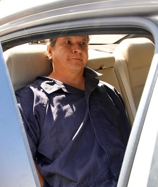 Marco Antonio Delgado sits inside a car outside of the El Paso County Jail, Monday, Nov. 5, 2012 in El Paso, Texas. Delgado was arrested by Immigration and Customs Enforcement on charges of conspiracy to commit money laundering according to jail records. (AP Photo/Juan Carlos Llorca)