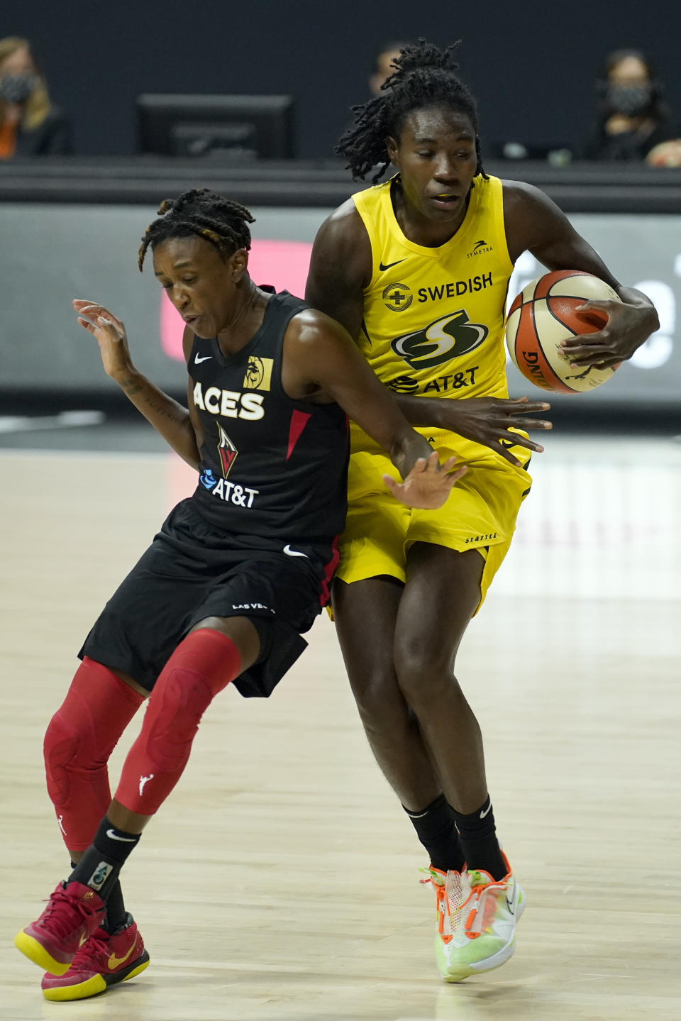 Seattle Storm forward Natasha Howard (6) and Las Vegas Aces guard Danielle Robinson (3) collide chaseing a loose ball during the first half of Game 1 of basketball's WNBA Finals Friday, Oct. 2, 2020, in Bradenton, Fla. (AP Photo/Chris O'Meara)