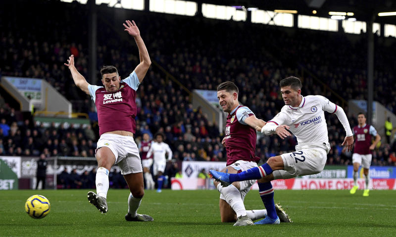 Chelsea's Christian Pulisic, right, scores his side's first goal of the game during the English Premier League soccer match at Turf Moor, Burnley, England Saturday Oct. 26, 2019. (Anthony Devlin/PA via AP)