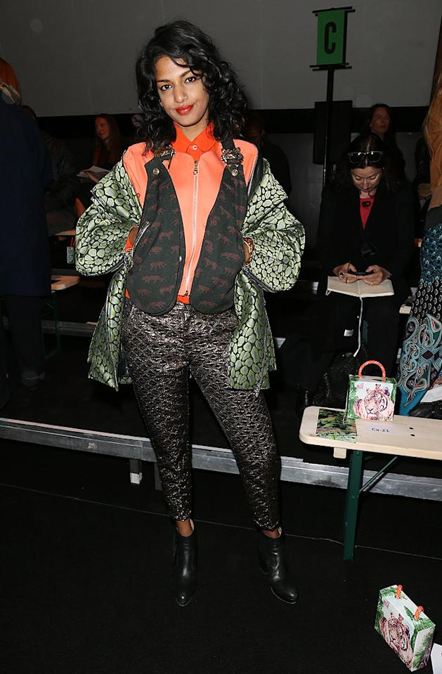 "M.I.A. -- best known for her smash hit ""Paper Planes"" and last February's Super Bowl halftime snafu -- is also becoming well-known for her incessant fashion flubs. A few days ago -- upon arriving at Kenzo's Paris Fashion Week presentation -- the Brit-born Sri Lankan popped a pose in this awkward ensemble, which featured a few too many layers, including tiger-adorned holsters and a Blanche Devereaux-like jacket. (9/30/2012) Follow What Were They Thinking?! creator, Matt Whitfield, on Twitter"