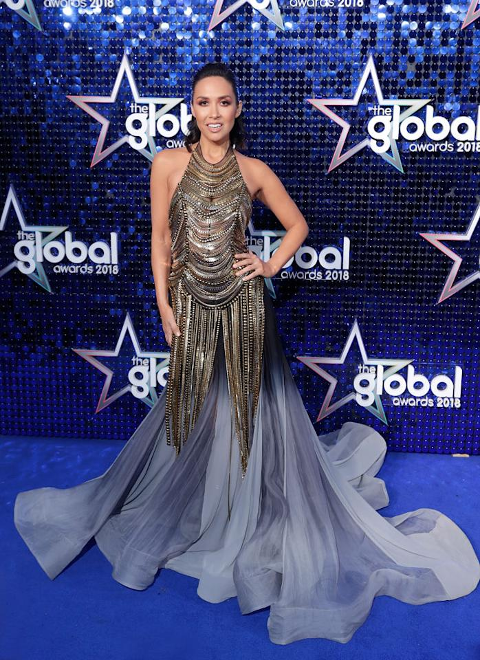<p>We can always count on Myleene Klass to wow us, and this dress is no exception. Covered with gold and silver embellishments, the dress flowed down with a grey train. (John Phillips/John Phillips/Getty Images) </p>