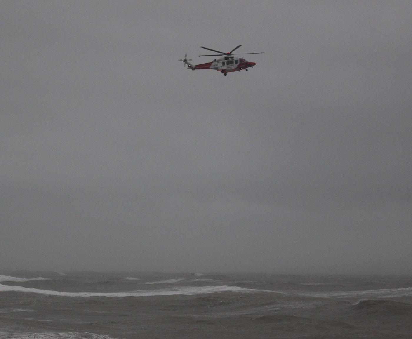 Handout photo from Hastings Council showing a RNLI helicopter off the coast of Hastings searching for a missing surfer, who was later found safe. PA Photo. Picture date: Sunday February 9, 2020. See PA story WEATHER Storm. Photo credit should read: Hastings Council /PA Wire NOTE TO EDITORS: This handout photo may only be used in for editorial reporting purposes for the contemporaneous illustration of events, things or the people in the image or facts mentioned in the caption. Reuse of the picture may require further permission from the copyright holder.
