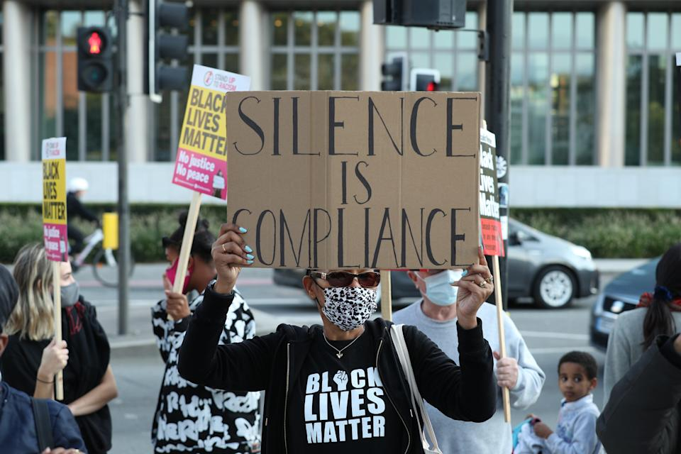 Protesters outside the US Embassy in London, as part of an anti-racism demonstration coinciding with the start of the trial of the four police officers charged with the murder of George Floyd in the US.