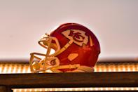 """<p>Even if you're not a Chiefs fan, you have to admit this background is regal looking. </p> <p> <a href=""""http://media1.popsugar-assets.com/files/2021/01/26/086/n/1922507/33237d58a8cdf8d4_tim-l-productions-ITl68hX9EoQ-unsplash/i/Kansas-City-Chief-Helmet-Zoom-Background.jpg"""" class=""""link rapid-noclick-resp"""" rel=""""nofollow noopener"""" target=""""_blank"""" data-ylk=""""slk:Download this Zoom background image here."""">Download this Zoom background image here.</a> </p>"""