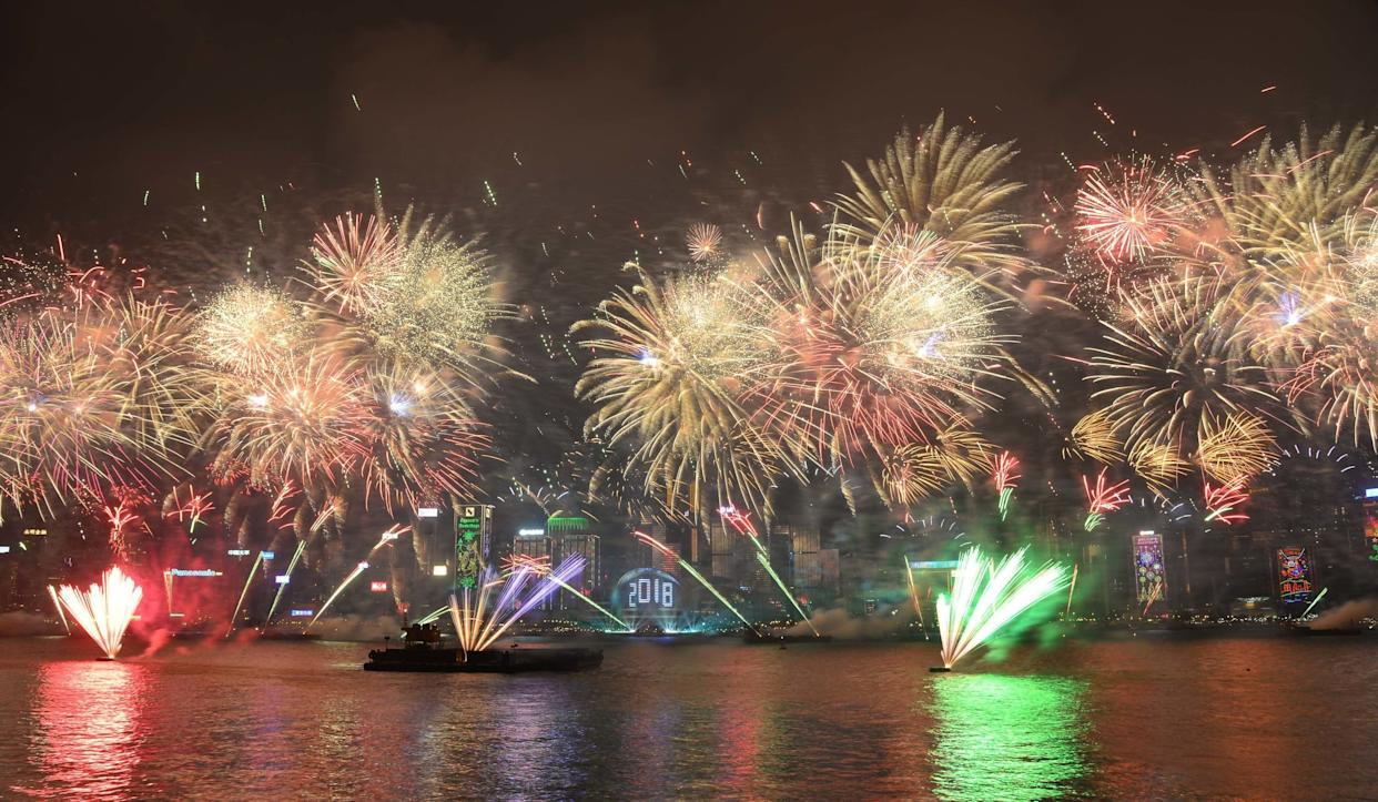Fireworks explode over Victoria Harbour on New Year's Eve in Hong Kong, China. (Photo: VCG via Getty Images)