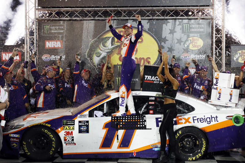 Denny Hamlin, center, celebrates after winning a NASCAR Cup Series auto race Saturday, Aug. 17, 2019, in Bristol, Tenn. (AP Photo/Wade Payne)