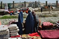During the Taliban's first rule from 1996 to 2001, women were largely excluded from public life including being banned from leaving their homes unless accompanied by a male relative (AFP/Hoshang Hashimi)