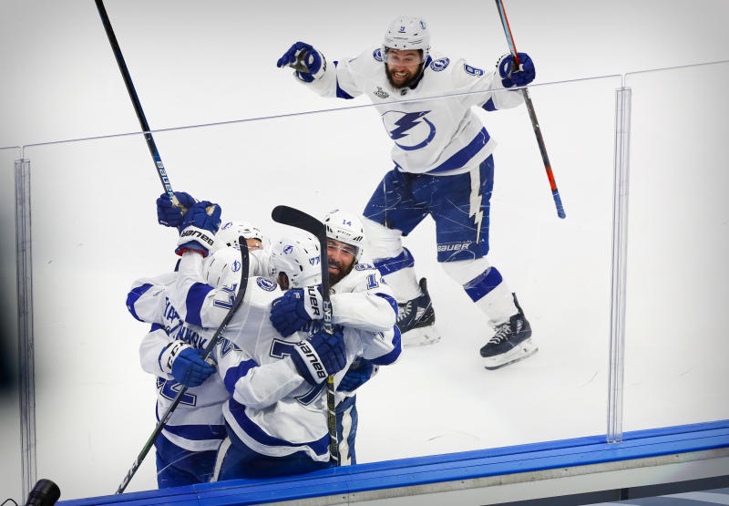 Sep 25, 2020; Edmonton, Alberta, CAN; Tampa Bay Lightning defenseman Kevin Shattenkirk (22) and defenseman Victor Hedman (77) and left wing Patrick Maroon (14) and center Tyler Johnson (9) celebrates a game winning goal scored by Shattenkirk against the Dallas Stars during the overtime period in game four of the 2020 Stanley Cup Final at Rogers Place. Mandatory Credit: Perry Nelson-USA TODAY Sports