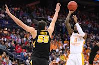 <p>Jordan Bone #0 of the Tennessee Volunteers shoots over Luka Garza #55 of the Iowa Hawkeyes in the second round of the 2019 NCAA Men's Basketball Tournament held at Nationwide Arena on March 24, 2019 in Columbus, Ohio. (Photo by Jamie Schwaberow/NCAA Photos via Getty Images) </p>