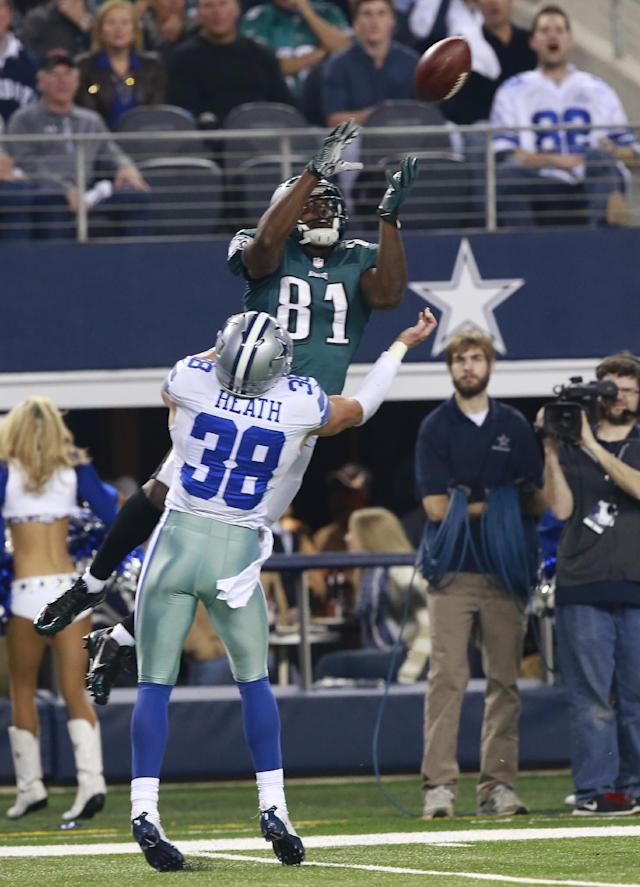 Philadelphia Eagles wide receiver Jason Avant (81) pulls in a catch for a first down, and is tackled by Dallas Cowboys strong safety Jeff Heath (38) in the first half of an NFL football game Sunday, Dec. 29, 2013, in Arlington, Texas. (AP Photo/The Waco Tribune-Herald, Jose Yau)