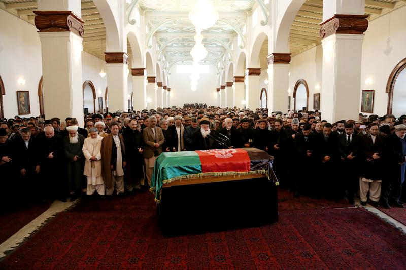Afghan President Hamid Karzai, center second row, prays amongst others during the funeral procession of Afghanistan's influential Vice President Mohammad Qasim Fahim in Kabul, Afghanistan, Tuesday, March 11, 2014. Fahim, a leading commander in the alliance that fought the Taliban who was later accused with other warlords of targeting civilian areas during the country's civil war, died on Sunday, March 9, 2014. He was 57. (AP Photo/Rahmat Gul)