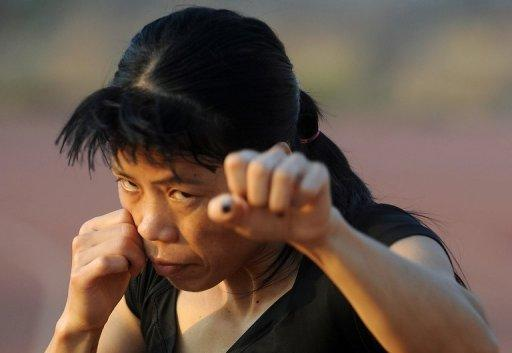 Indian woman boxer MC Mary Kom warms up during a training session in Pune in April 2012. The women pugilists are delighted to have got their shot at Olympic gold and have some genuine talent coming through with Indian hopes high that their legend MC Mary Kom will deliver gold in the flyweight category