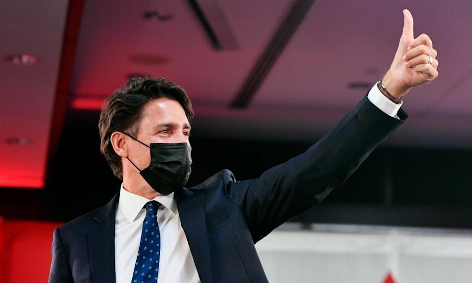 Justin Trudeau greets supporters with a thumbs-up as he celebrates his election victory in Montreal.