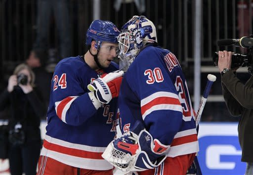 New York Rangers right wing Ryan Callahan (24) celebrates the Rangers 2-0 shutout of the New Jersey Devils after their NHL hockey game at Madison Square Garden in New York, Monday, Feb. 27, 2012. Callahan shot an empty net goal in the third. (AP Photo/Kathy Willens)