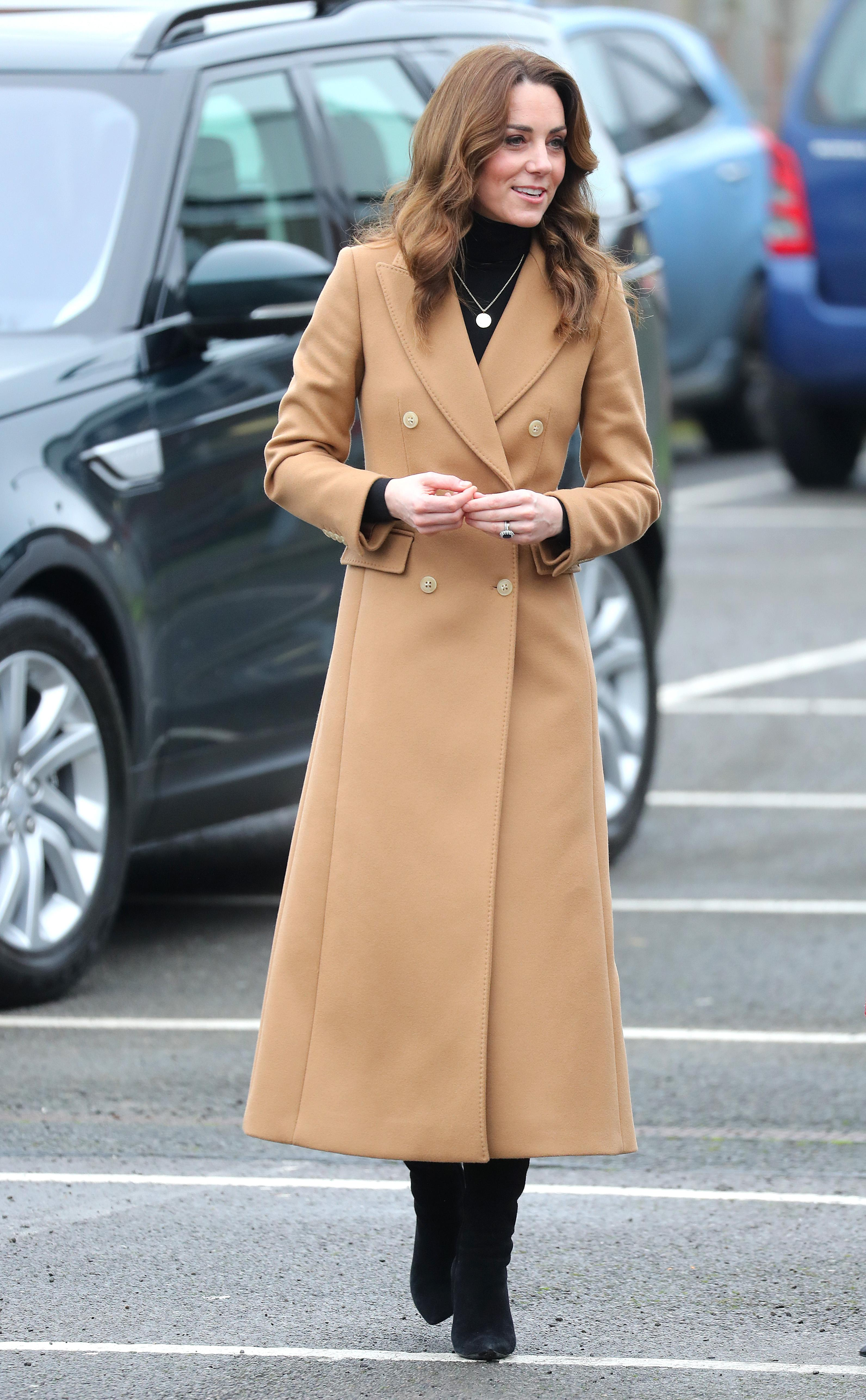 Duchess of Cambridge arrived wearing a camel coat by Massimo Dutti. [Photo: Getty]