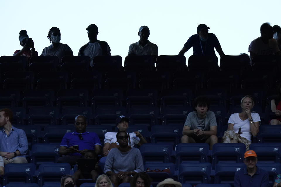 Fans watch a match in Louis Armstrong Stadium during the first round of the US Open tennis championships, Monday, Aug. 30, 2021, in New York. (AP Photo/Frank Franklin II)