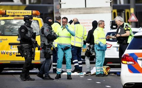 Police forces and emergency services stand at the 24 Oktoberplace in Utrecht - Credit: Robin Van Lonkhuijsen/AFP
