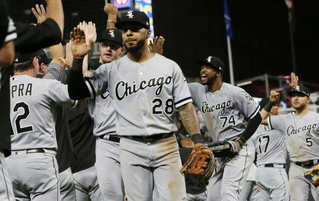 Chicago White Sox's Leury Garcia (28), Eloy Jimenez (74) and others celebrate their team's 3-1 win over the Minnesota Twins in a baseball game Wednesday, Sept. 18, 2019, in Minneapolis. (AP Photo/Jim Mone)