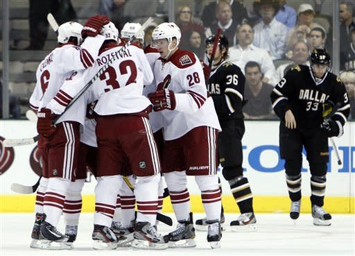 Phoenix Coyotes left wing Lauri Korpikoski (28), of Finland, is congratulated David Schlemko (6); Michal Rozsival (32), of the Czech Republic; and others following his goal against the Dallas Stars in the first period of an NHL hockey game Tuesday, March 20, 2012, in Dallas. Stars' Philip Larsen (36) and Alex Goligoski (33) are at rear. (AP Photo/Tony Gutierrez)