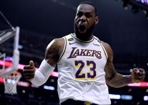 Los Angeles Lakers LeBron James celebrate his basket and Los Angeles  Clippers foul during a 112-103 Lakers win at Staples Center