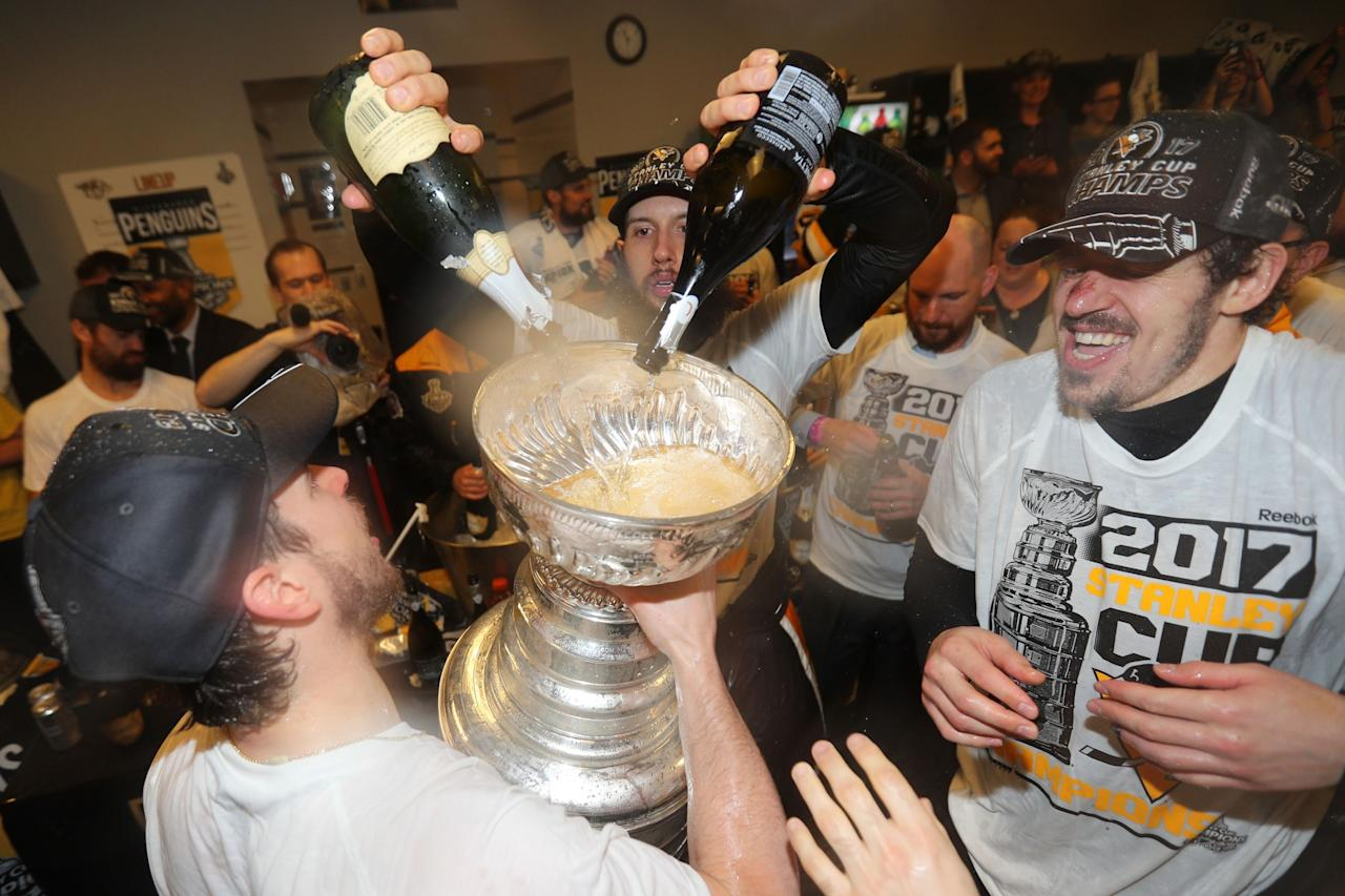 <p>Pittsburgh Penguins center Nick Bonino pours champagne into the Stanley Cup after defeating the Nashville Predators in Game 6 of the 2017 Stanley Cup Final at Bridgestone Arena. Credit: Dave Sandford/NHLI/Pool Photo via USA TODAY Sports </p>