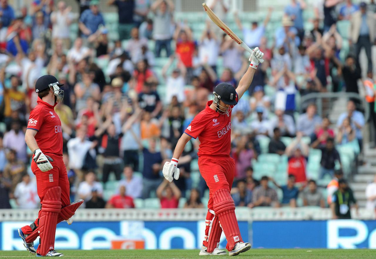 England's Eoin Morgan (left) looks-on as Jonathan Trott celebrates hitting the winning runs during the ICC Champions Trophy, Semi Final at the Oval, London.