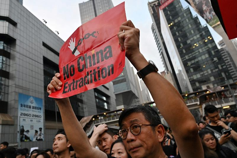 Analysts say the suspension of the Hong Kong extradition law is a setback for Chinese President Xi Jinping (AFP Photo/HECTOR RETAMAL)