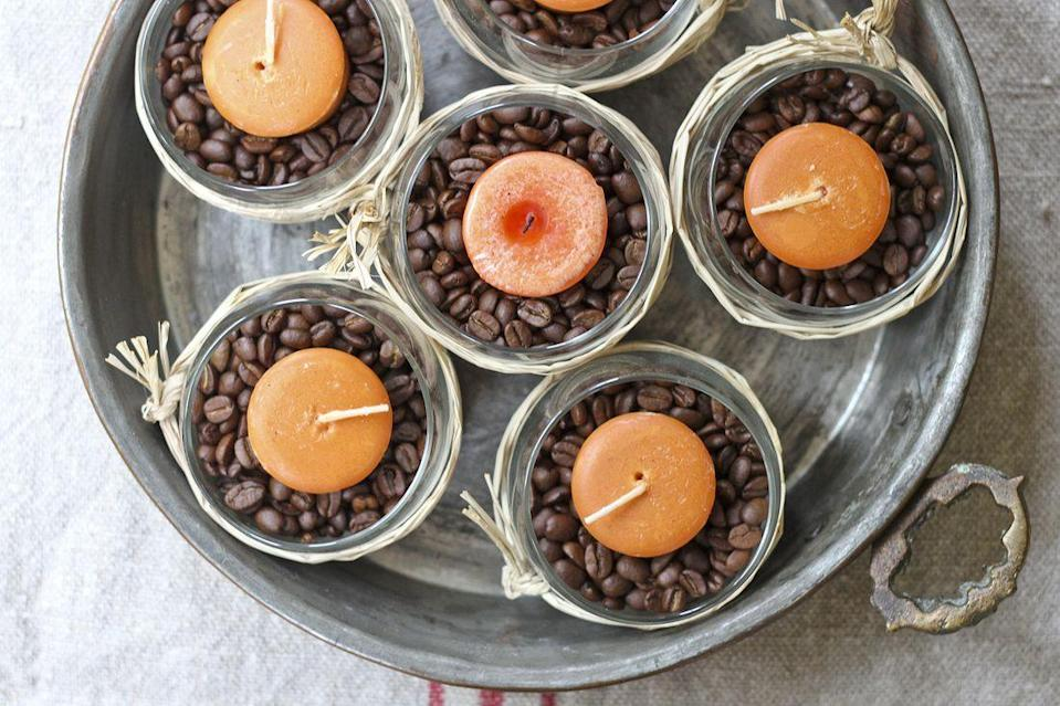 "<p>With coffee beans and pumpkin spice candles, this easy-to-make centerpiece smells as good as it looks.</p><p><em><a href=""http://www.calmcradle.com/blog/fall-diy-simple-candle-and-coffee-bean-centerpiece"" rel=""nofollow noopener"" target=""_blank"" data-ylk=""slk:Get the tutorial at Calm Cradle »"" class=""link rapid-noclick-resp"">Get the tutorial at Calm Cradle »</a></em></p>"