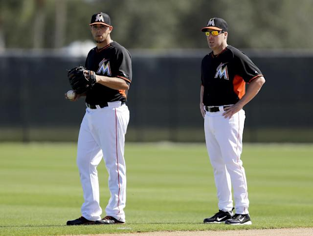 Miami Marlins pitcher Jose Fernandez, left, and manager Mike Redmond talk during spring training baseball practice Sunday, Feb. 16, 2014, in Jupiter, Fla. (AP Photo/Jeff Roberson)