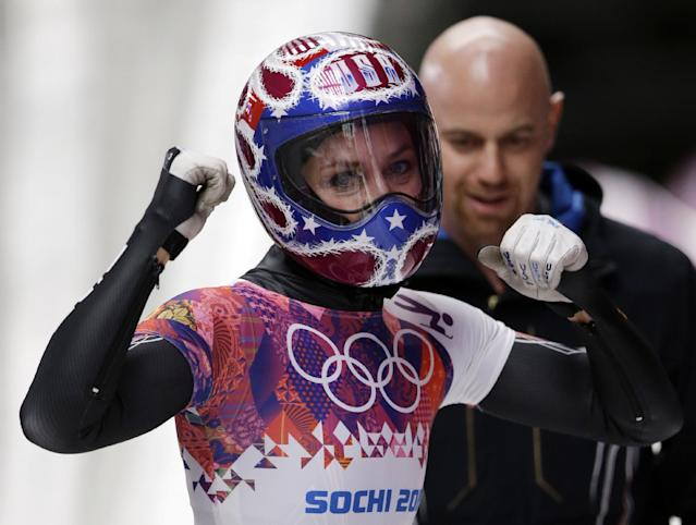Noelle Pikus-Pace of the United States pumps her fists after her third run during the women's skeleton competition at the 2014 Winter Olympics, Friday, Feb. 14, 2014, in Krasnaya Polyana, Russia. (AP Photo/Dita Alangkara)
