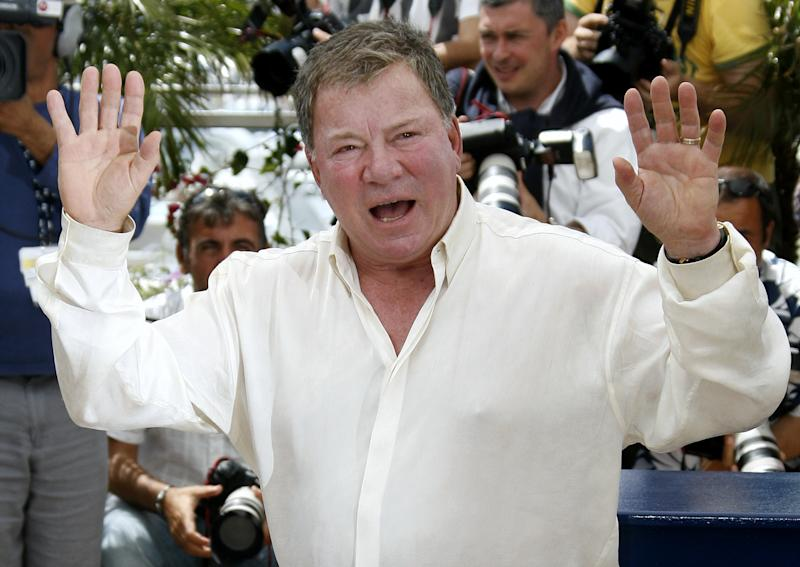U.S. actor William Shatner waves as he leaves a photocall for directors Karey Kirkpatrick and Tim Johnson's out of competition animated film 'Over the Hedge' at the 59th Cannes Film Festival May 21, 2006. REUTERS/John Schults