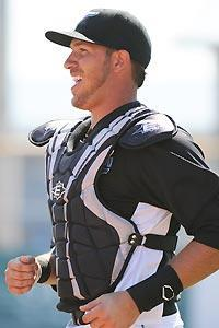 J.P. Arencibia wants to prove his defense can match his offensive potential. (Al Messerschmidt/Getty)