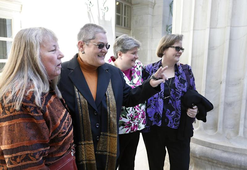 Plaintiffs challenging Oklahoma's gay marriage ban arrive in court following a hearing at the 10th U.S. Circuit Court of Appeals in Denver, Thursday, April 17, 2014. They are, left to right, Dr. Gay Phillips, her partner Sue Barton, Sharon Baldwin and her partner Mary Bishop. The court is to decide whether to overturn a federal judge's decision to strike down. (AP Photo/Brennan Linsley)