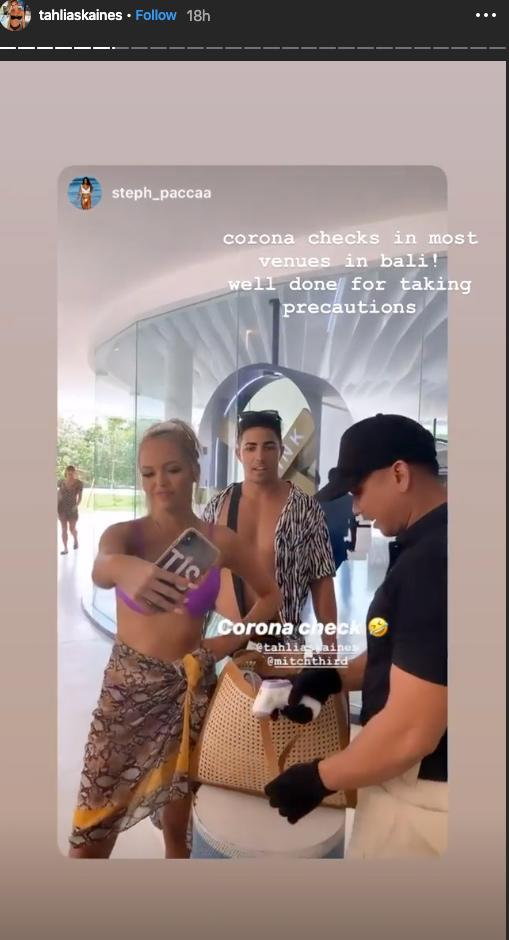 A group of Instagram influencers appearing to have their temperatures checked at Cafe Del Mar beach club in Bali amid coronavirus fears.