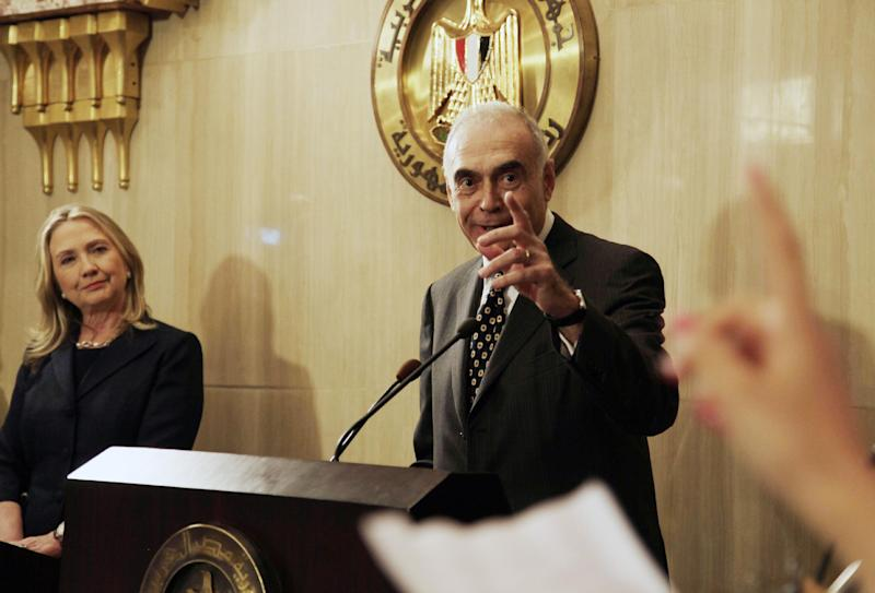 "FILE - In this Saturday, July 14, 2012 file photo, Egyptian Foreign Minister Mohammed Kamel Amr, right, takes a reporter's question at a joint press conference with U. S. Secretary of State Hillary Rodham Clinton at the presidential palace in Cairo, Egypt. Egypt has asked the United States to push Israel to stop its offensive against Hamas militants in the Gaza Strip, warning that the violence could ""escalate out of control."" Egypt's Foreign Ministry says in a statement released Thursday, Nov. 15, 2012 that Foreign Minister Mohammed Amr spoke with U.S. Secretary of State Hillary Rodham Clinton late the night before, asking for ""immediate U.S. intervention to stop the Israeli aggression."" (AP Photo/Maya Alleruzzo, File)"