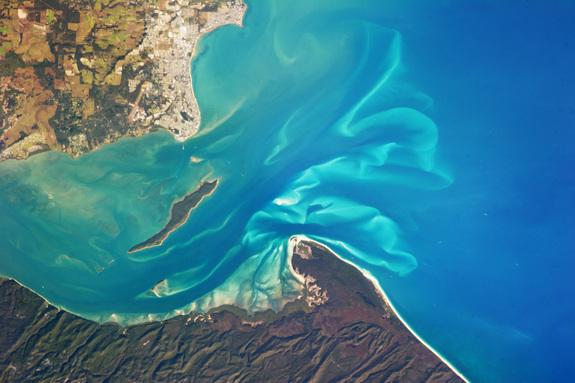 The Great Sandy Strait is an estuary that separates the coastline of the state of Queensland, Australia, from neighboring Fraser Island.