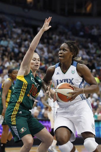 Minnesota Lynx forward Taj McWilliams-Franklin (8) looks to the basket against Seattle Storm guard Sue Bird (10) in the first half of Game 1 of the WNBA basketball first-round playoff series Friday, Sept. 28, 2012, in Minneapolis. (AP Photo/Stacy Bengs)