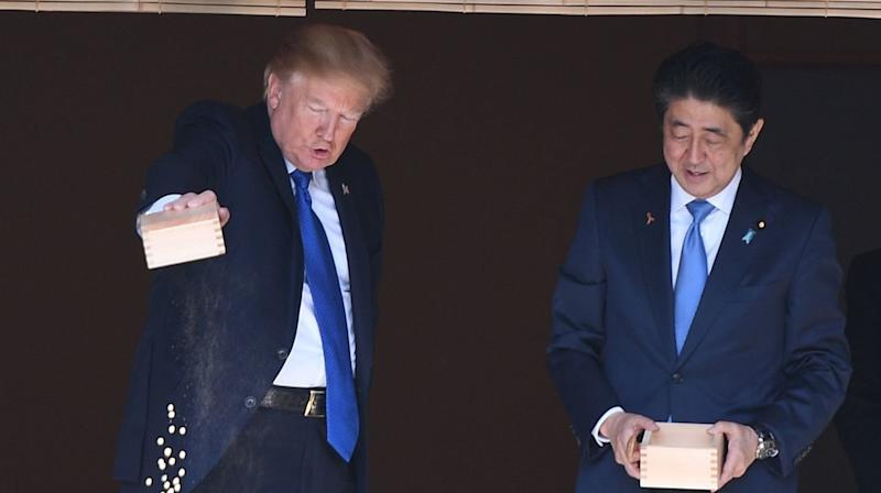 Watch As Trump And Japanese Leader Totally Give Up On Feeding Fish In Japan